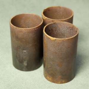 Copper tube sections with layer of tarnish.